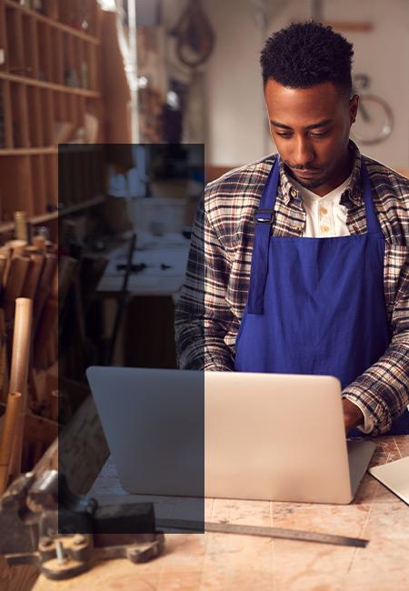 Freelance carpenter working on his website