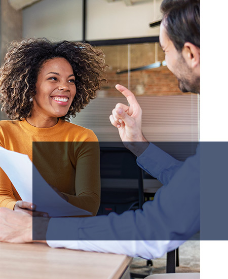 Lady and man in meeting discussing side hustle