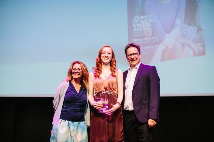 Iona Bain on stage with award after winning Freelancer of the Year