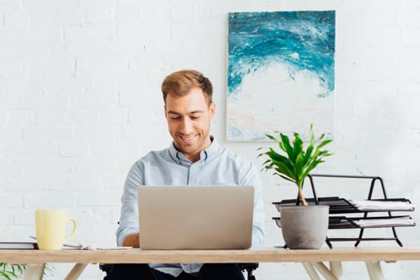 freelancer working on laptop at desk