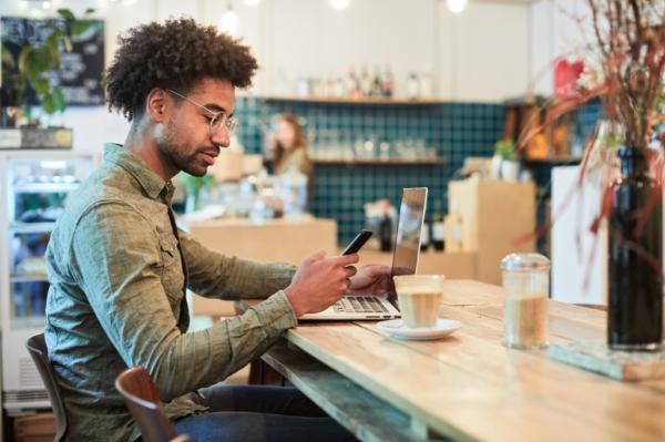 freelancer working on phone in coffee shop