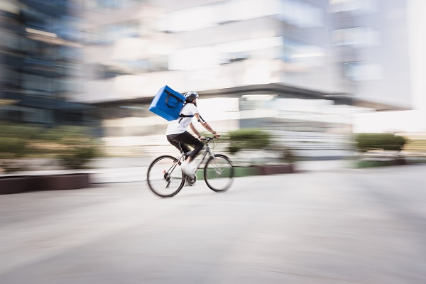 Gig economy worker cycling for delivery