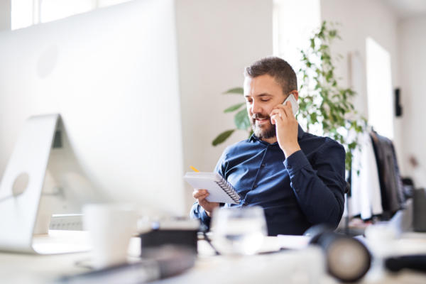 freelancer on the phone working at desk