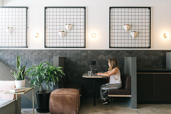 freelancer with laptop in co-working space